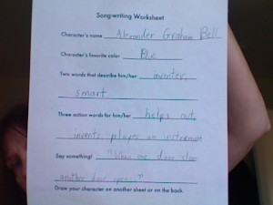 A student proposes a song about Alexander Graham Bell.
