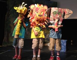 Cast members model animal masks.