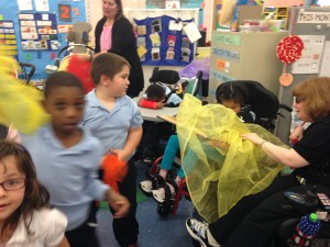 A kindergarten class has fun with scarves during a visit to the DDC class at Condon School.