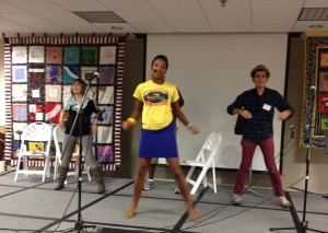 Culture Queen Jessica Smith leads a song in the CMN Round Robin, joined by Alina Celeste and Andres Salguero.