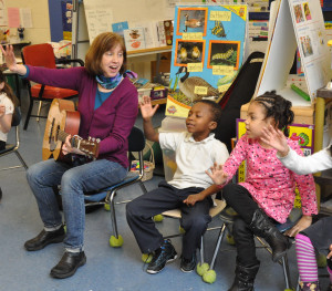 Kindergarteners enjoy a literacy lesson with a musical component.