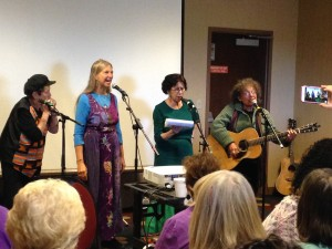 Uncle Ruthie, Sarah Pirtle, Suni Paz and Ruth Pelham lead a song at the CMN conference. All have been honored with CMN's Magic Penny Award for lifetime achievement in children's music.